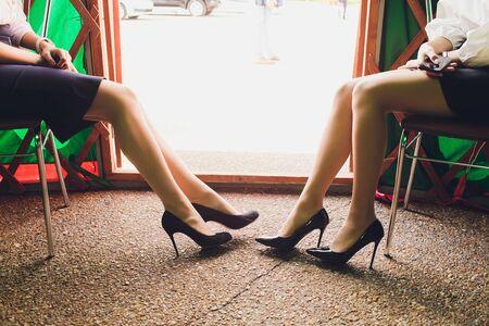 beautiful tanned female lags in high heels, studio shot.
