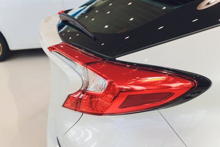 Car detail. New led taillight by night. The rear lights of the car, in hybrid sports car. Developed Cars rear brake light. Stock fotó