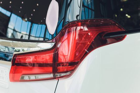 Car detail. New led taillight by night. The rear lights of the car, in hybrid sports car. Developed Cars rear brake light.