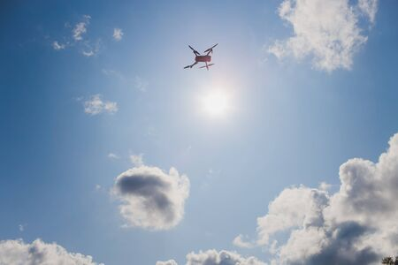 Flying drone with blue sky background, new technology.