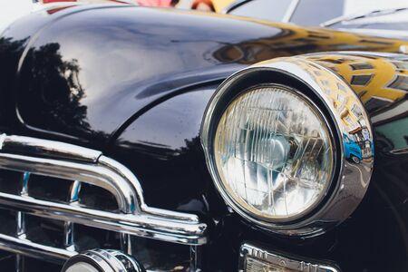 View of black classic vintage Soviet car Gaz.