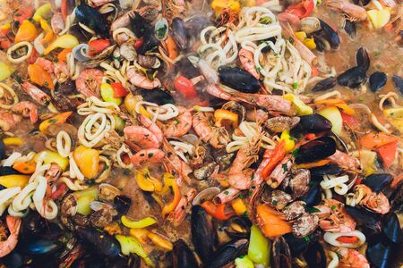 Paella seafood is cooked in a large capacity. Large.
