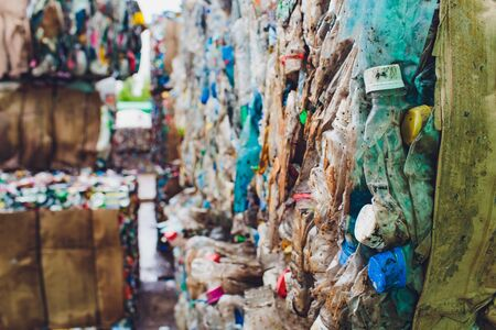 Plastic pressed bales at the modern waste hazardous processing plant. Separate garbage collection. Recycling and storage of waste for further disposal. Business for sorting and processing of waste. selective focus Stok Fotoğraf