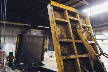 Special equipment for pressing paper waste at a waste sorting plant for further disposal or recycling.