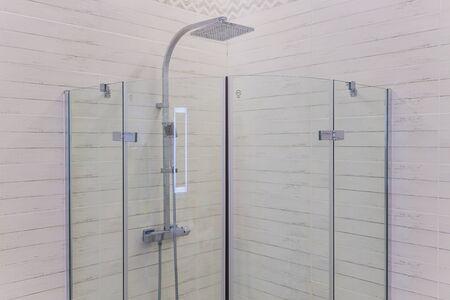Detail of a modern glass shower cabin.