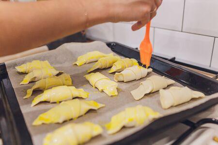 baker concept. Make wheat croissant on wooden table , fresh bakery. Standard-Bild - 131911788