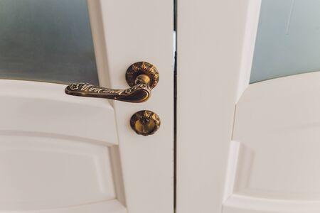 Antique interior doorknob on an old wooden door