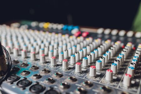 the mixer. remote for sound recording. sound engineer at work in the studio. sound amplifier mixing console equalizer. record songs and vocals. mixing tracks. audio equipment. work with musicians. DJ. 版權商用圖片