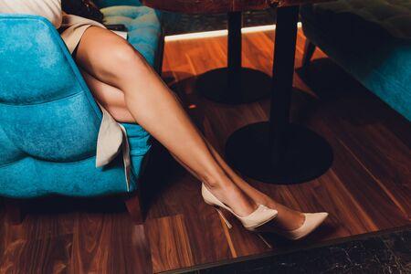 Close up of elegant female legs on background.
