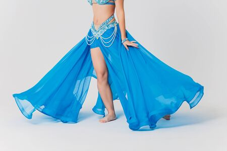 Portrait of belly dancer girl in blue. isolated on white. Standard-Bild - 131315376