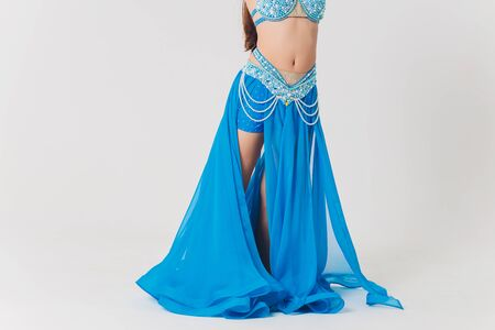 Portrait of belly dancer girl in blue. isolated on white. Standard-Bild - 131315382