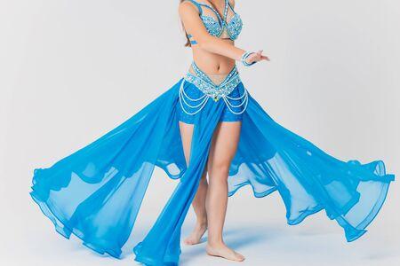 Portrait of belly dancer girl in blue. isolated on white. Standard-Bild - 132379586