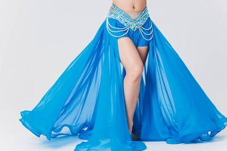 Portrait of belly dancer girl in blue. isolated on white.
