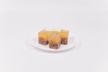 Jellied, aspic cooked from beef, pork, chicken with mustard on a plate close-up. Stock Photo