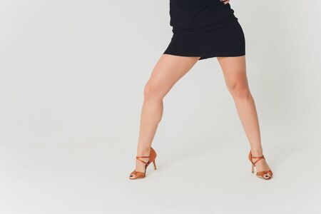 Close up shoes for pole dance with high heels on legs.