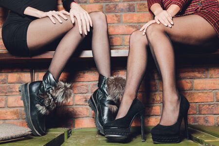 Beautiful female legs in black pantyhose in a restaurant. Stockfoto