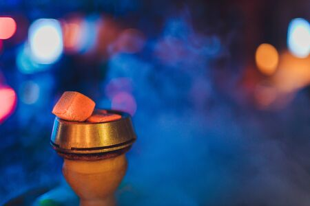 hookah hot coals for smoking and leisure in natural lighting.