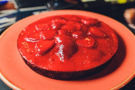 strawberry tart with ricotta filling on the plate.