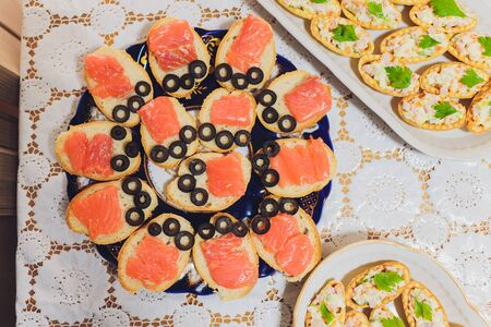 Different types of canapes on buffet table. Stock fotó
