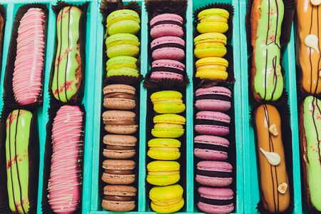 blue gift box with eclairs and macaroon. Stock fotó