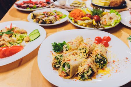 Food Table Celebration Delicious Party Meal Concept. A lot of food. Served for wedding, anniversary, other holiday. Banquet dishes in the restaurant