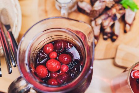 Fresh homemade stewed cherries in a cup.