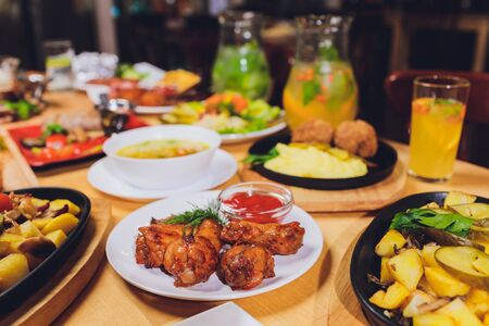 Dining table with a variety of snacks and salads. Salmon, olives, wine, vegetables, grilled fish toast. The concept of a family celebratory dinner. Thanksgiving, Christmas. top veiw. Stockfoto