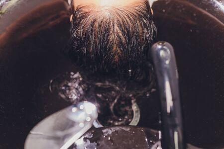 hair stylist washing woman hair with shampoo Reklamní fotografie