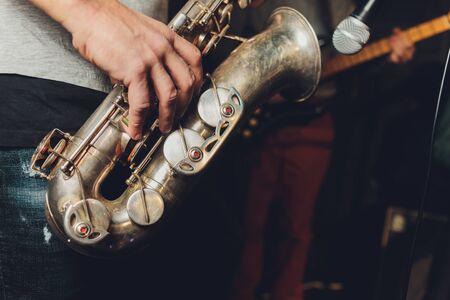 Saxophone player jazz musician. Saxophonist with baritone sax player. Stock fotó