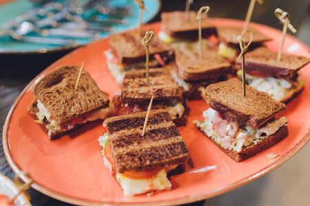 Mini Club Sandwich with chicken beacon ham, Egg Salad Cold Cuts Brioche Sandwiches for Catering, Seminar, Coffee Break, Breakfast, Lunch, Dinner, Buffet and meeting Group