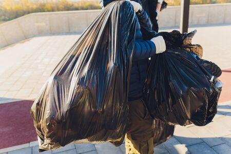 volunteers clean up trash in a park and on trails.