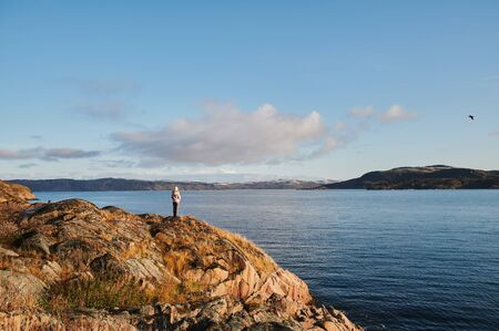Beautiful summer day landscape abandoned artnature coastal defense North Teriberka, Barents sea view. couple admiring the view Stock Photo