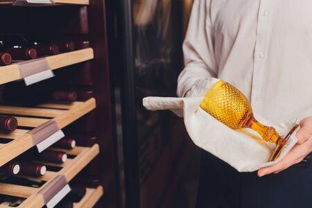 Storing bottles of wine in fridge. Alcoholic card in restaurant. Cooling and preserving wine Standard-Bild