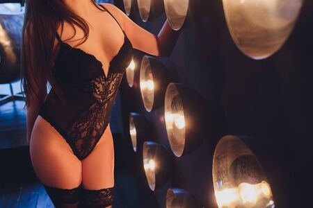 Sexy maid. Hot girl. Luxury ass. Stockings. Slender legs. Game costume. Athletic body. Girl in black lingerie and stockings. Temptation. Silicone implants. Buttocks.