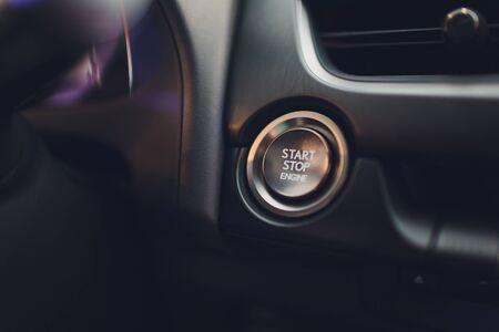Car driver starting the engine keyless. Black