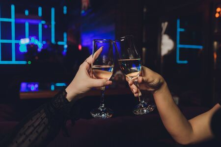 Clinking glasses with alcohol and toasting, party Reklamní fotografie