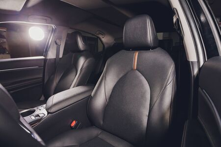 Black leather seat in a car cabin. 版權商用圖片