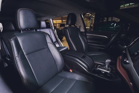 Black leather seat in a car cabin.