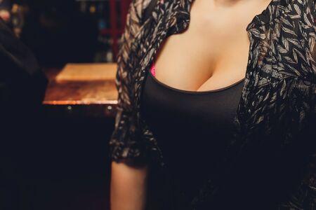 black short sweater with neckline female breast.