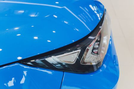 Closeup headlights of car white body close-up blue body 版權商用圖片