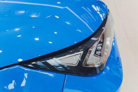 Closeup headlights of car white body close-up blue body Standard-Bild