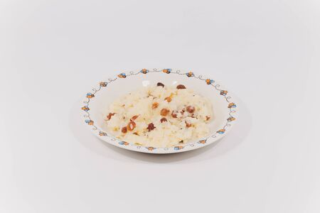 Rice dish with roasted almonds and dried raisins isolated on white. 版權商用圖片