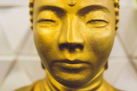 Golden buddha statue isolated on white background. Imagens