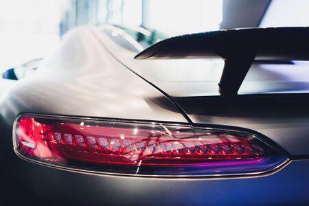 rear spoiler on a grey english sportscar.