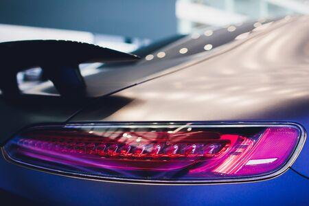 rear spoiler on a grey english sportscar
