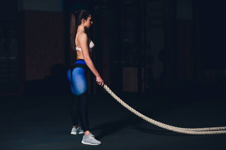 beautiful athletic woman working out with ropes box gym copyspace confidence motivation sports lifestyle activity hobby healthy powerful femininity training.