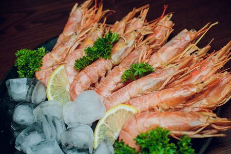 Prawns with lemon and rosemary. Top view. Square image.