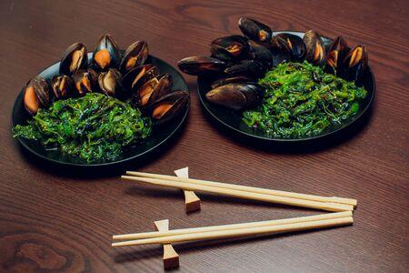 Green Chuka Seaweed Salad Top View. Wakame Sea Kelp mussels.