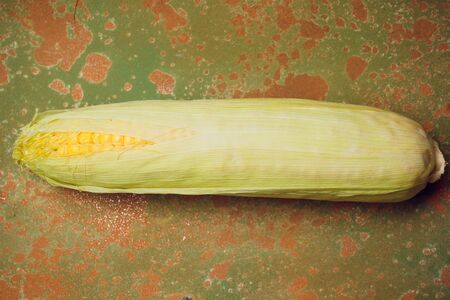 Boiled corn with tops. Yellow agriculture organic vegetarian fresh summer food close up