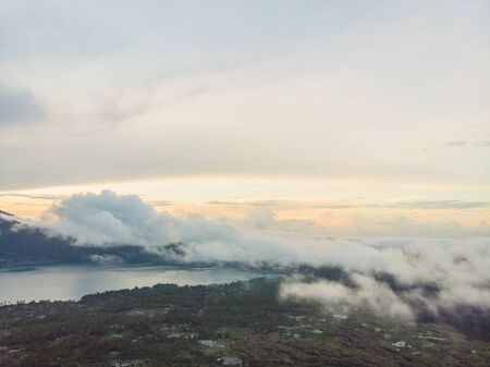 Scenic view of clouds and mist at sunrise from the top of mount Batur Kintamani volcano , Bali, Indonesia